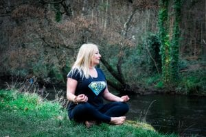 Anna Teague yoga pose by the river, image 2
